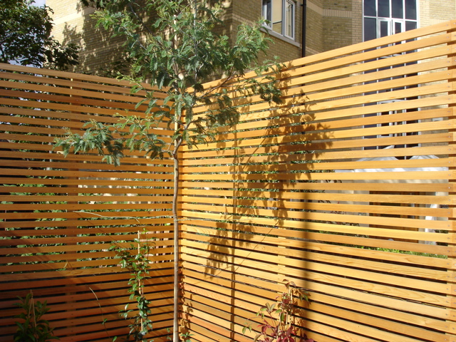 Privacy screens london garden design for Wooden garden screen designs