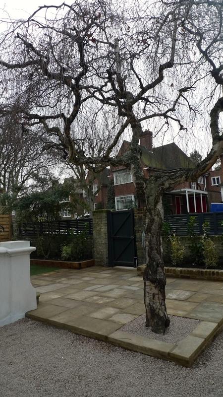 yorkstone-york-stone-patio-entrance-raised-bed-stock-wall-limestone-chipping-driveway-london.JPG