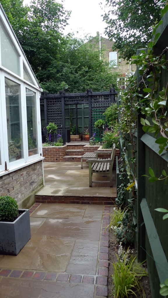 indian-sandstone-patio-paving-retaining-walls-formal-planting-brick-edge-patio-streatham-london.JPG