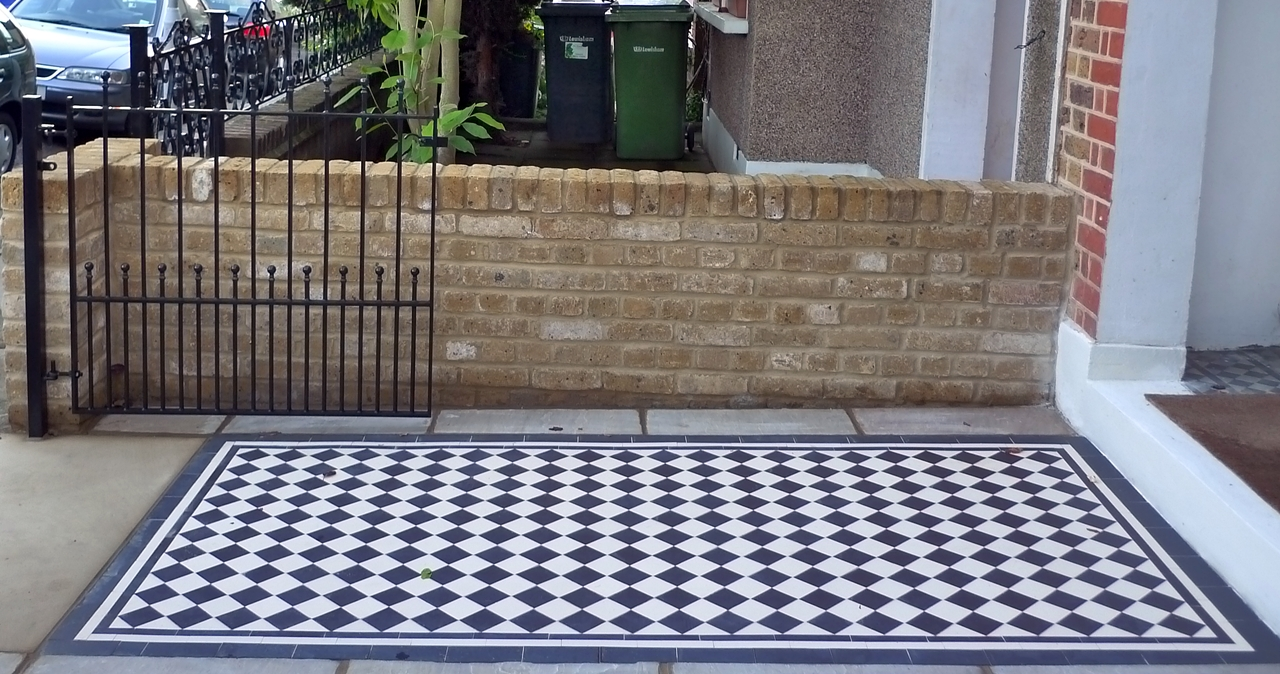 black-and-white-tile-path-yellow-brick-wall-and-bespoke-gate-london.JPG