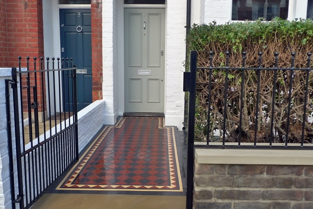 cream-terracota-and-black-mosaic-tile-path-with-metal-rails-and-old-stock-wall-with-stone-caps-london.JPG