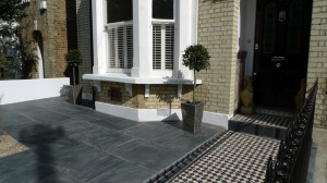 formal front garden london wall slate paving mosaic path