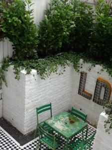 victorian mosaic courtyard garden with white walls and simple elegant planting