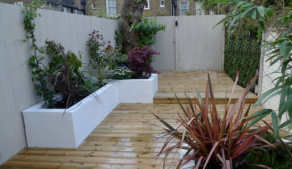 raised beds painted white decking stone paint colour fences modern garden design balham london