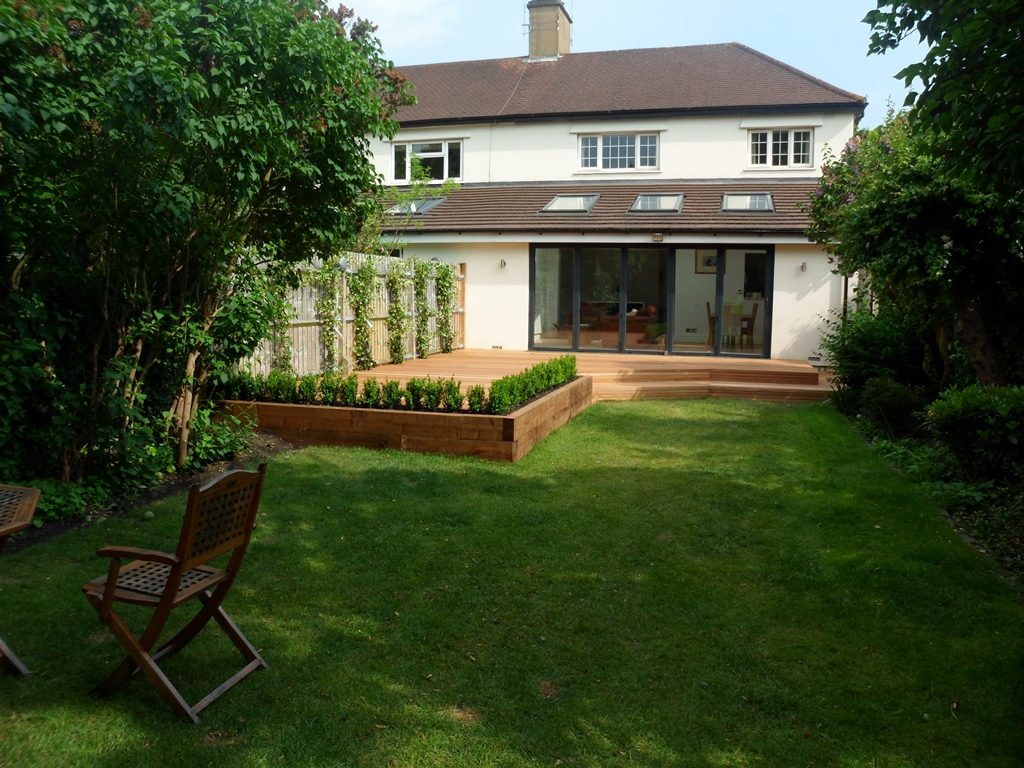 balau hardwood decking patio with steps and raised beds with buxus hedge london