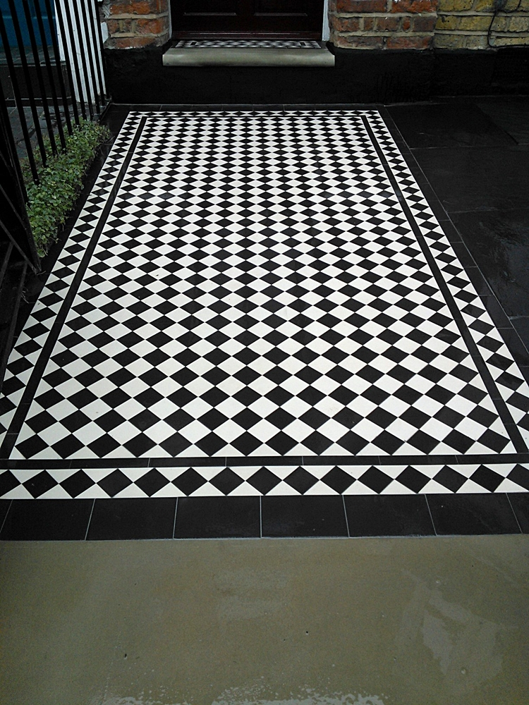 York stone black and white mosaci tile path with diamond border london