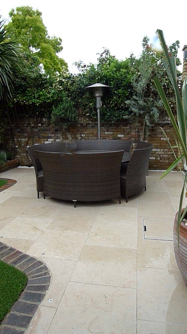 limestone tile paving slab patio in garden in clapham london