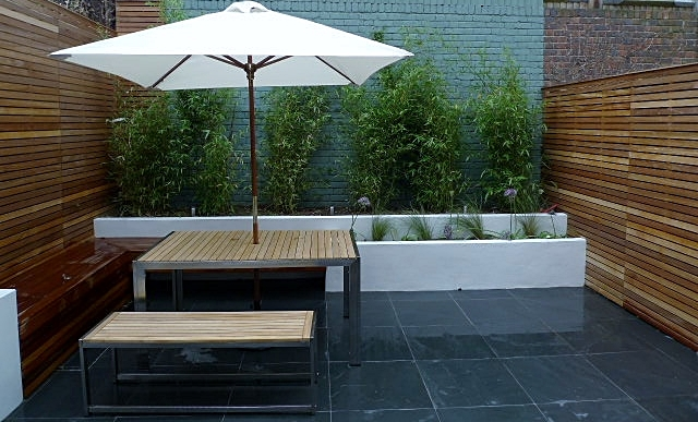 slate paving hardwood privacy screen trellis clapham garden design london