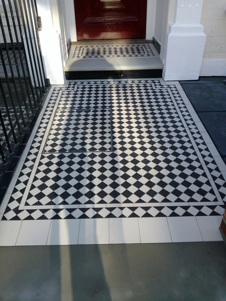 black and white victorian mosaic tile path with york stone clapham london