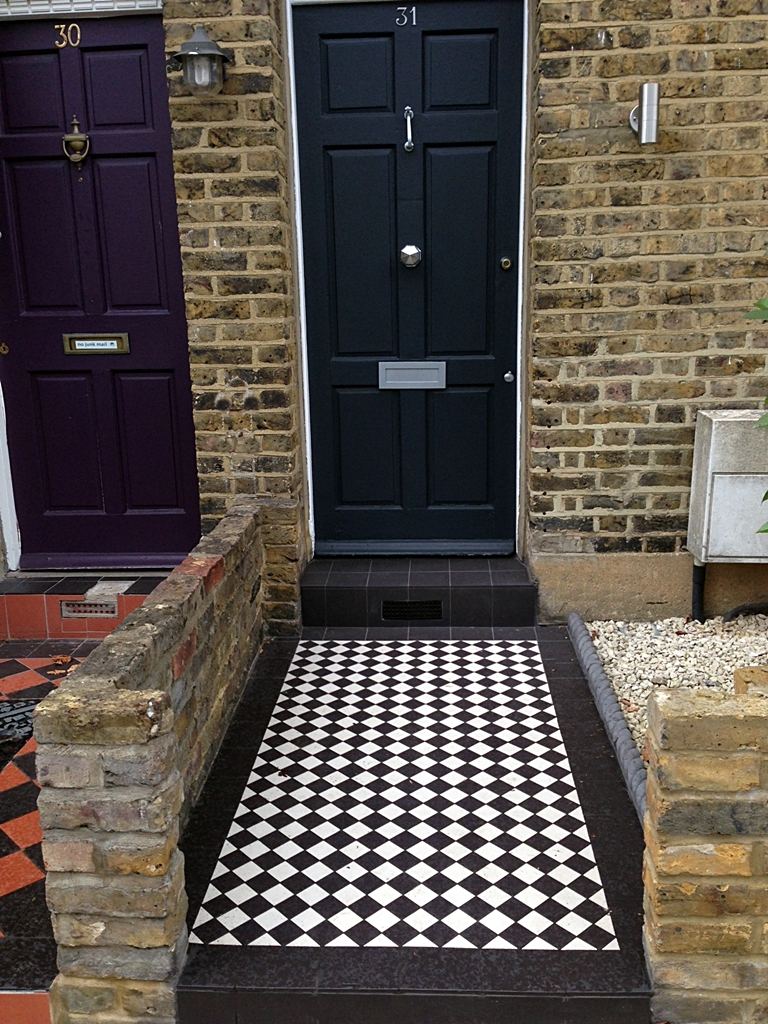 black and white victorian mosaic tile path