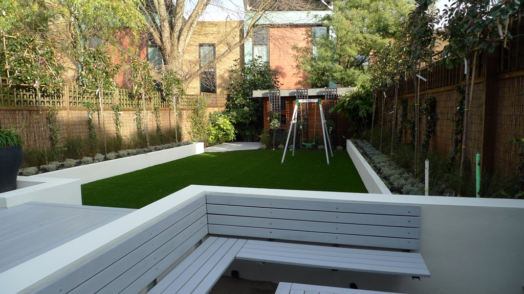 large modern garden design london raised beds lawn grey decking flat trees