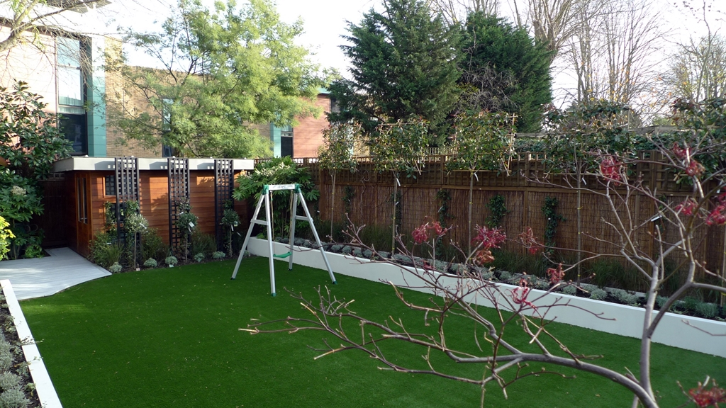 render plastered raised beds flat hedge trees artificial grass london