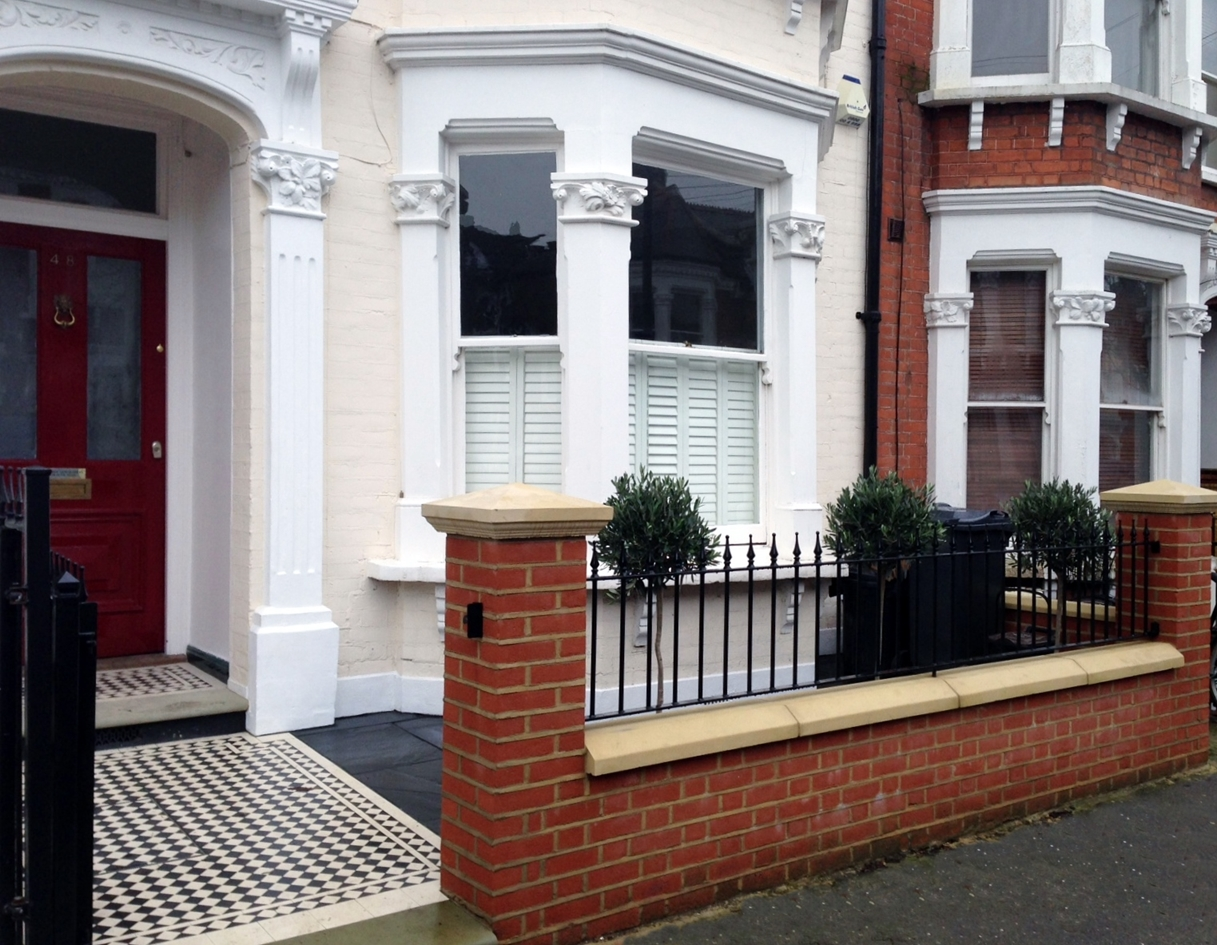 red brick garden wall london and victorian mosaic tile path