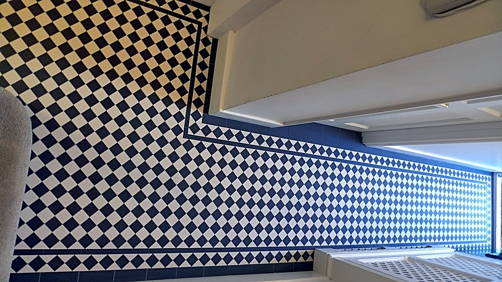 black and white mosaic tile path hallway london