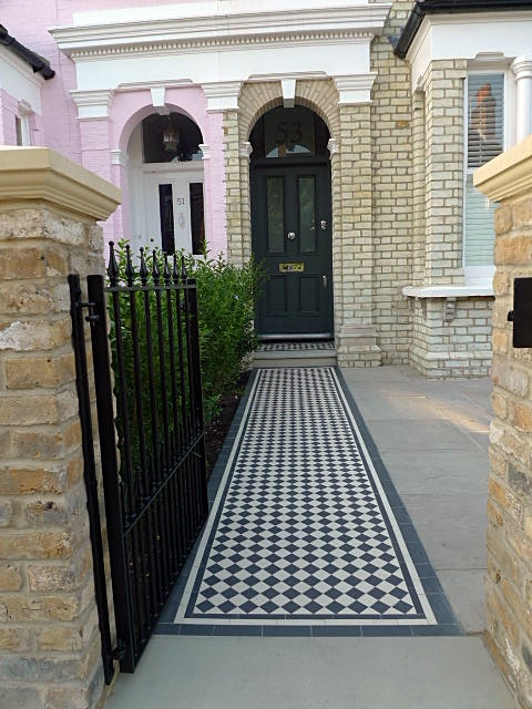 black and white mosaic tile path with york stone and sandstone paving