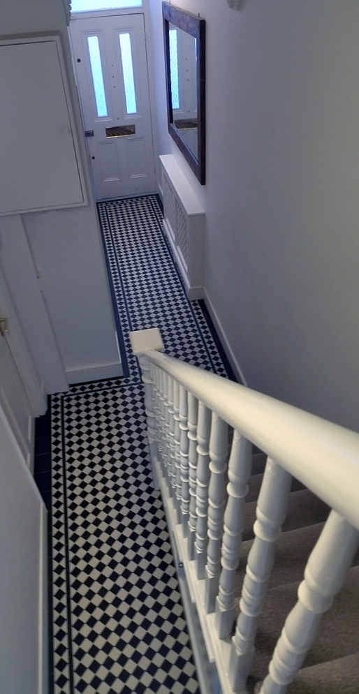 black and white victorian mosaic hallway tile path