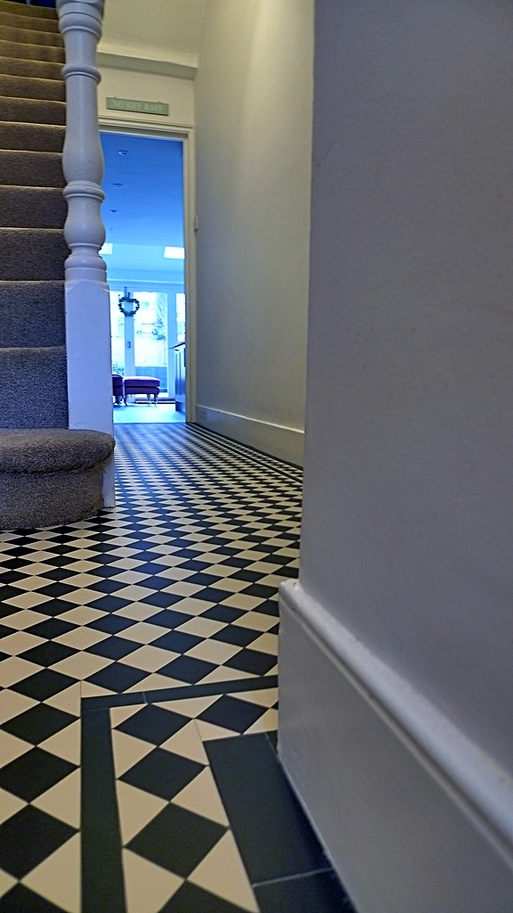 classic victorian edwardian black and white mosaic hallway tile path London