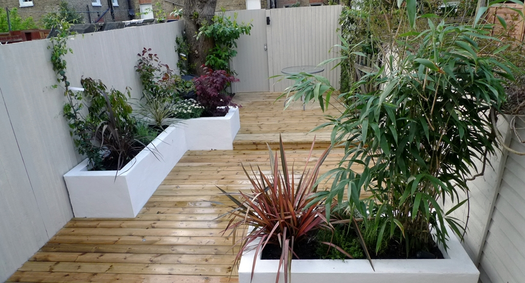decking raised beds stone coloured fence landscaping London
