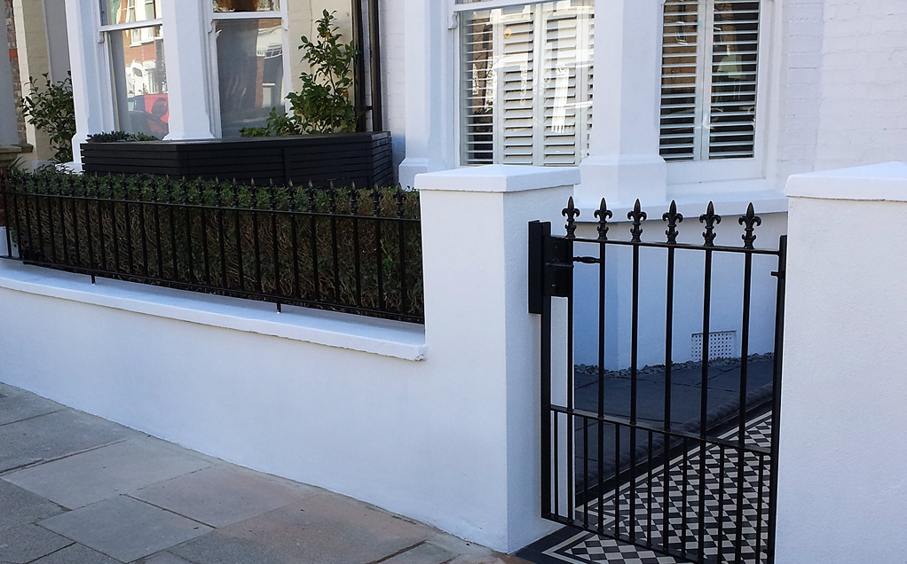 front garden wall and metal gate and rail london