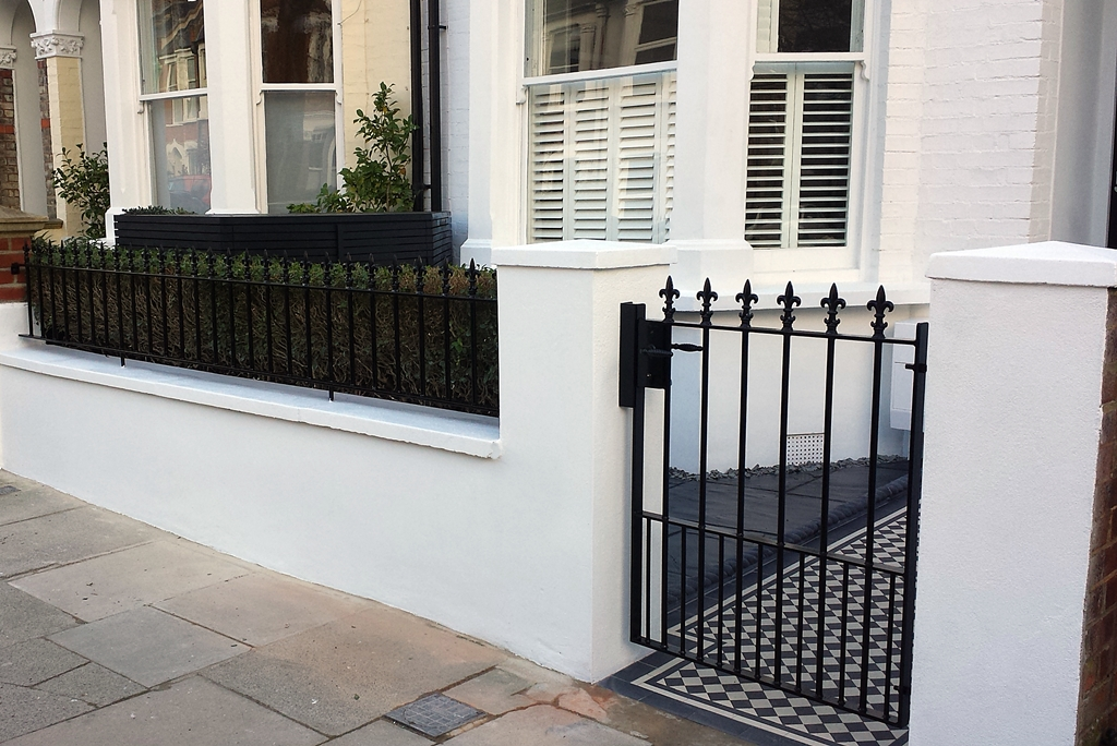 front garden wall metal rail and gate black and white mosaic tile path london