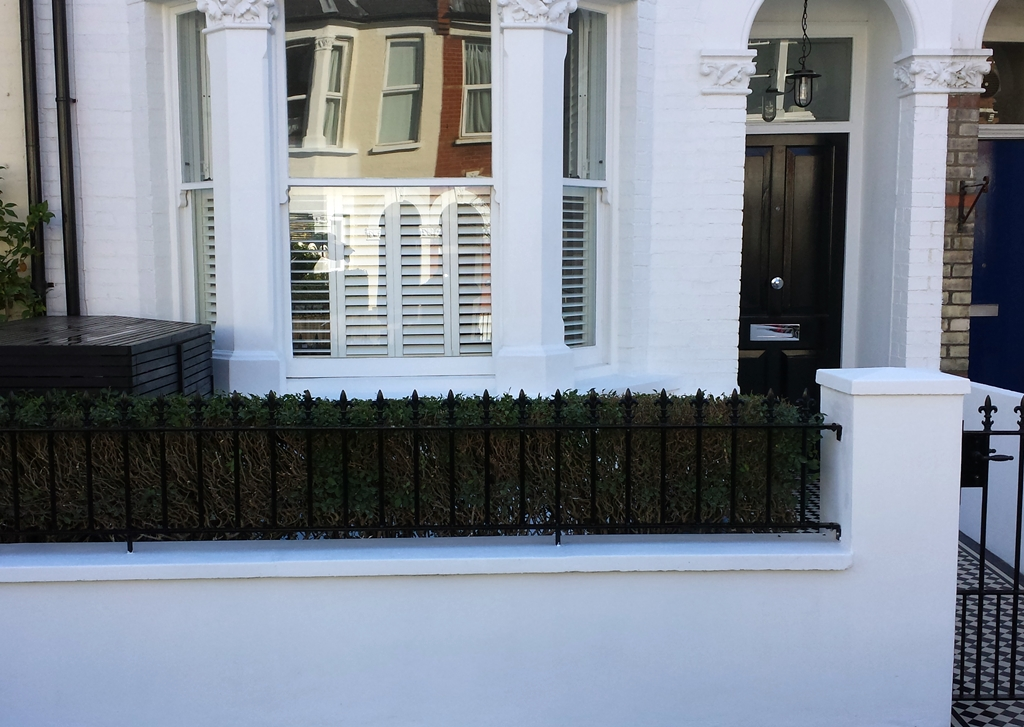front garden wall with meatl rail