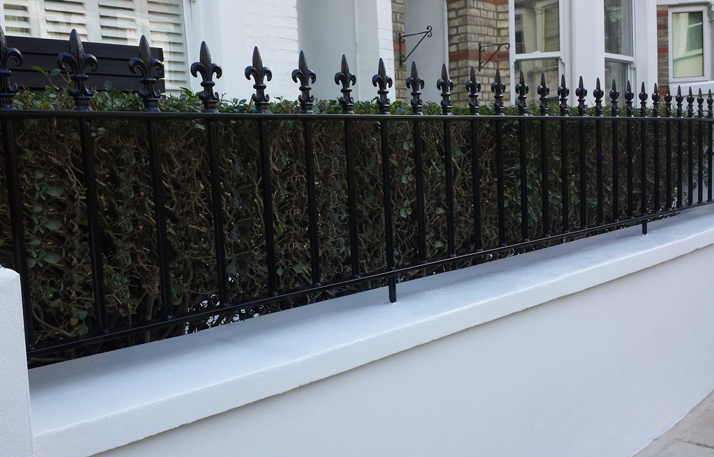 render front block wall with wrought iron rail metal gate london