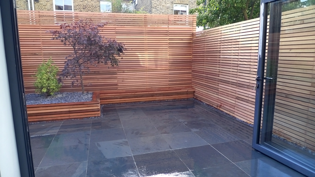 Ten great paving stones for a new patio london garden blog for Wooden garden screen designs