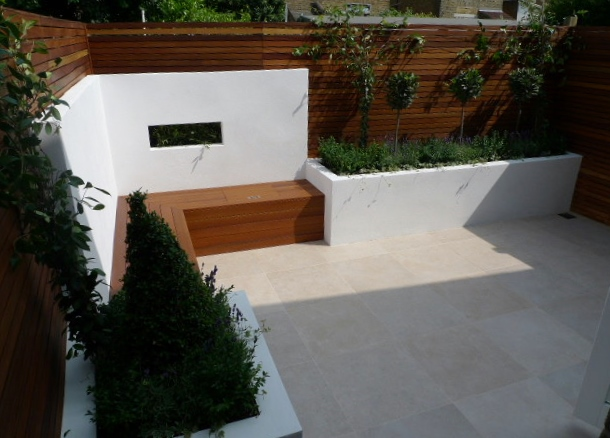 slatted trellis hardwood privacy screen within modern garden design courtyard garden london