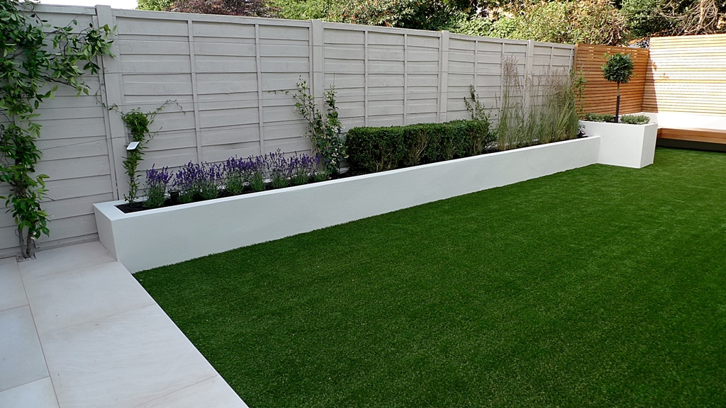 Grey fence white painted wall garden yard pinterest for Modern garden decking designs