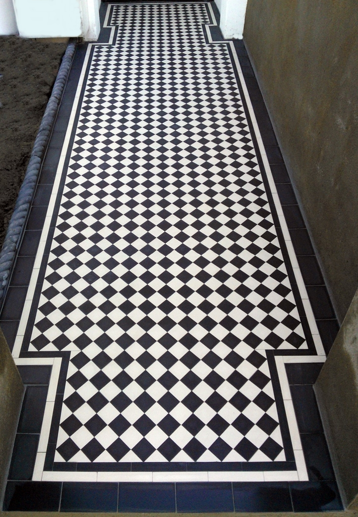 victorian black and white chequer board mosaic tile garden path London