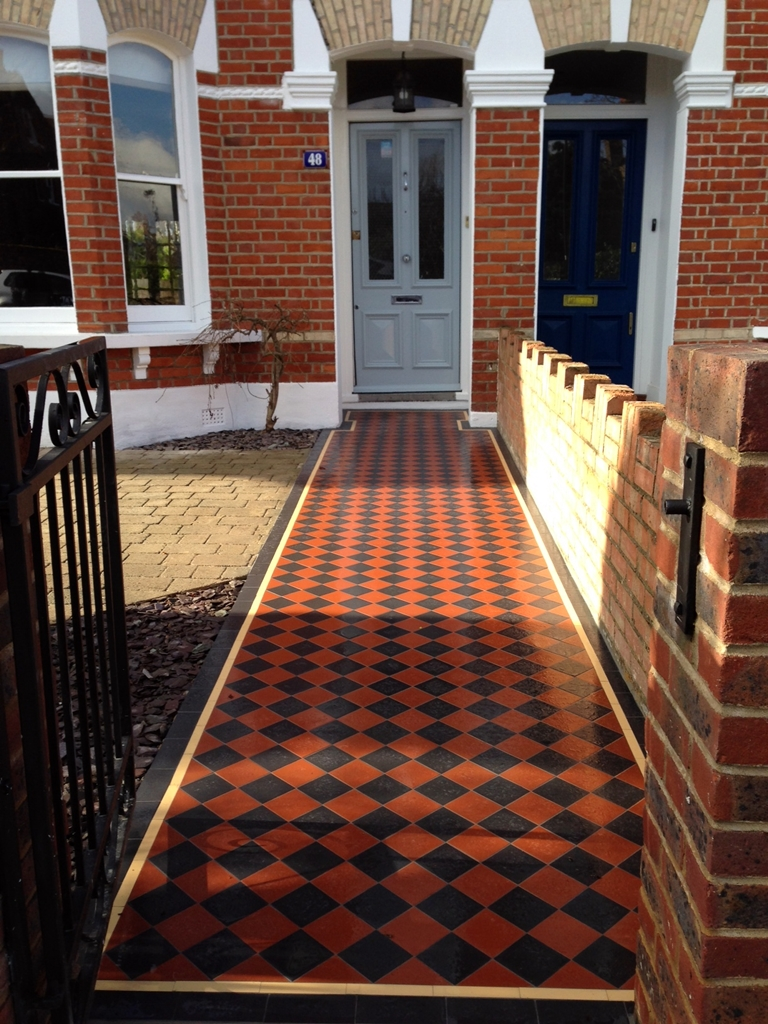 victorian mosaic front garden tile path in black and terracotta with cream and black border  london