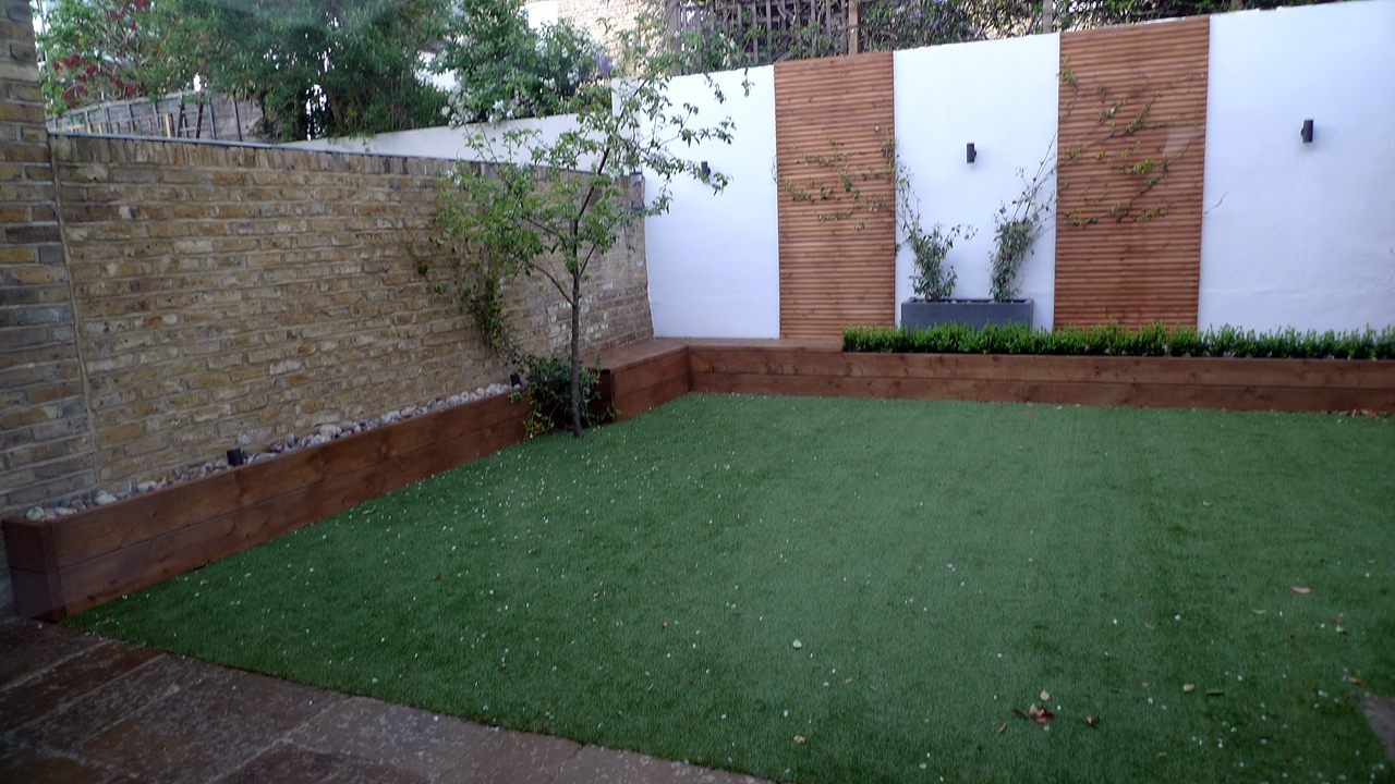 fake grass raised beds rendered walls trellis screens brick wall