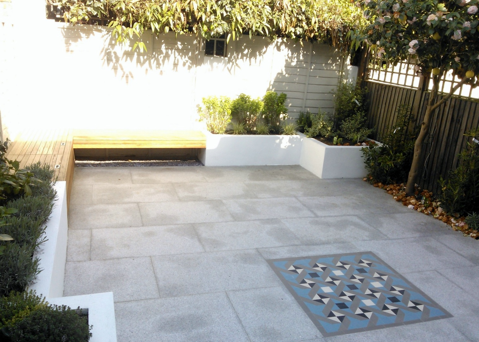 Modern London Garden Design Painted Fence Granite Paving Hardwood Bench Raised Painted beds architectural Planting West London (2)
