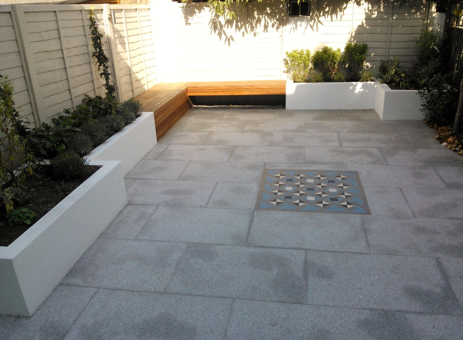 Modern London Garden Design Painted Fence Granite Paving Hardwood Bench Raised Painted beds architectural Planting West London (3)