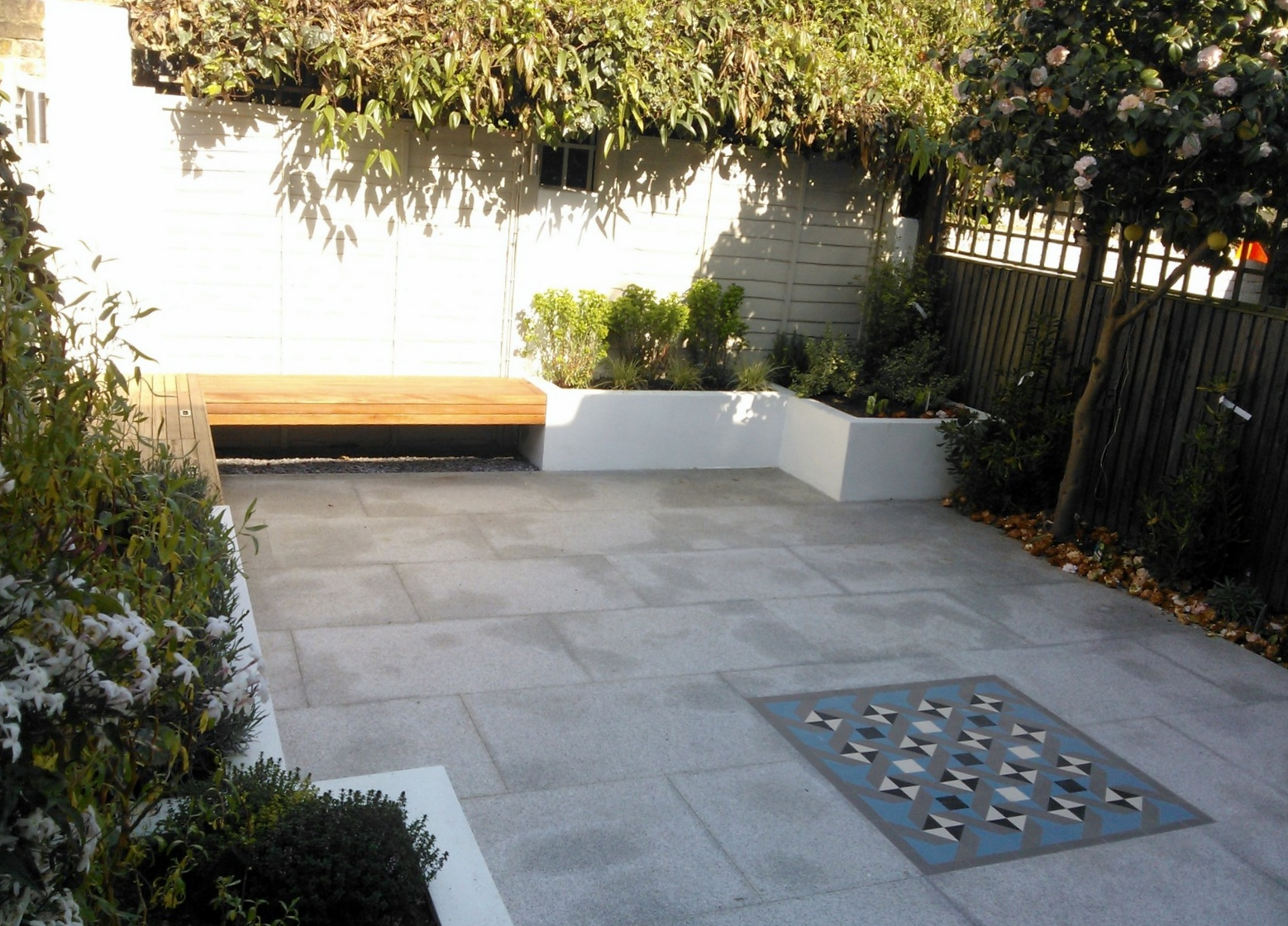 Modern London Garden Design Painted Fence Granite Paving Hardwood Bench Raised Painted beds architectural Planting West London