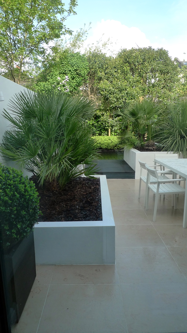 Modern Urban London Garden Design limestone paving white raised beds black decking architectural planting (1)