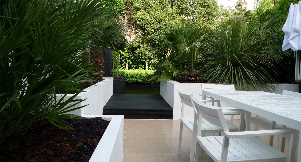 Modern Urban London Garden Design limestone paving white raised beds black decking architectural planting (11)