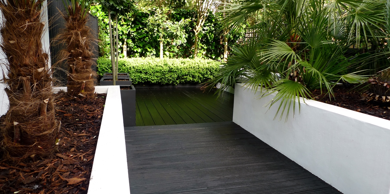 Modern Urban London Garden Design limestone paving white raised beds black decking architectural planting (12)