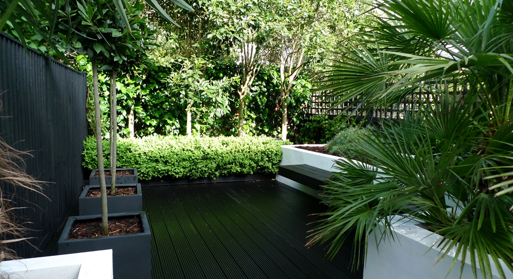 Modern Urban London Garden Design limestone paving white raised beds black decking architectural planting (13)