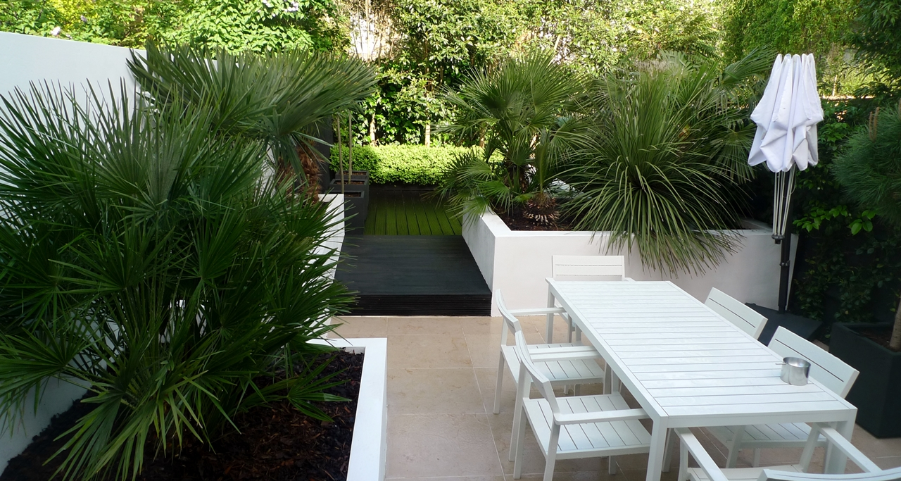 Modern Urban London Garden Design limestone paving white raised beds black decking architectural planting (5)