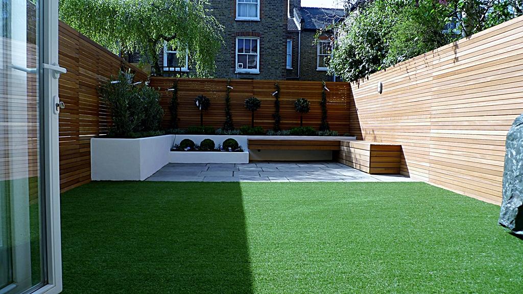 modern garden design courtyard easy lawn grass cedar hardwood privacy screen trellis low maintenance planting sandstone patio paving London (11)