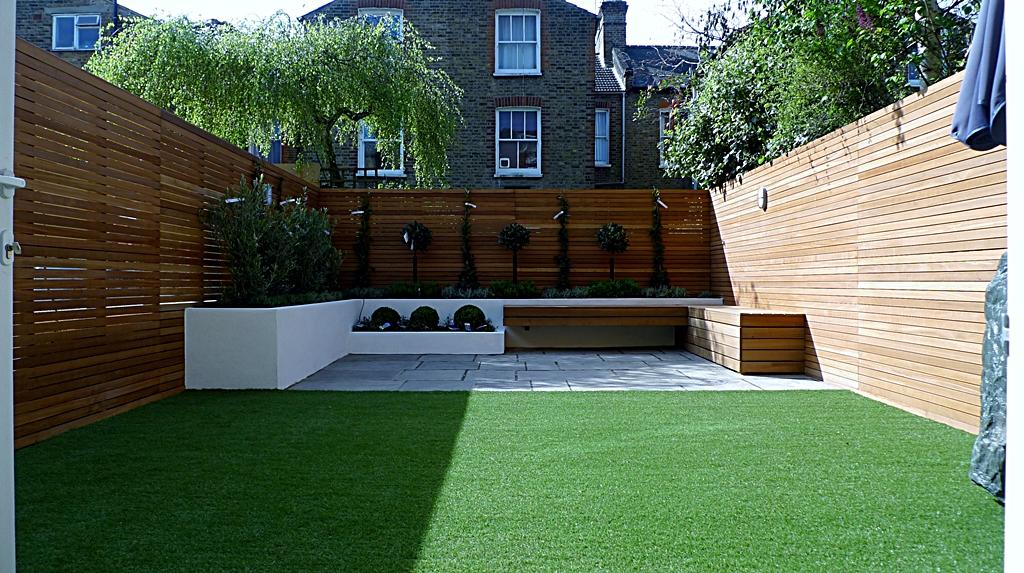 modern garden design courtyard easy lawn grass cedar hardwood privacy screen trellis low maintenance planting sandstone patio paving London (9)
