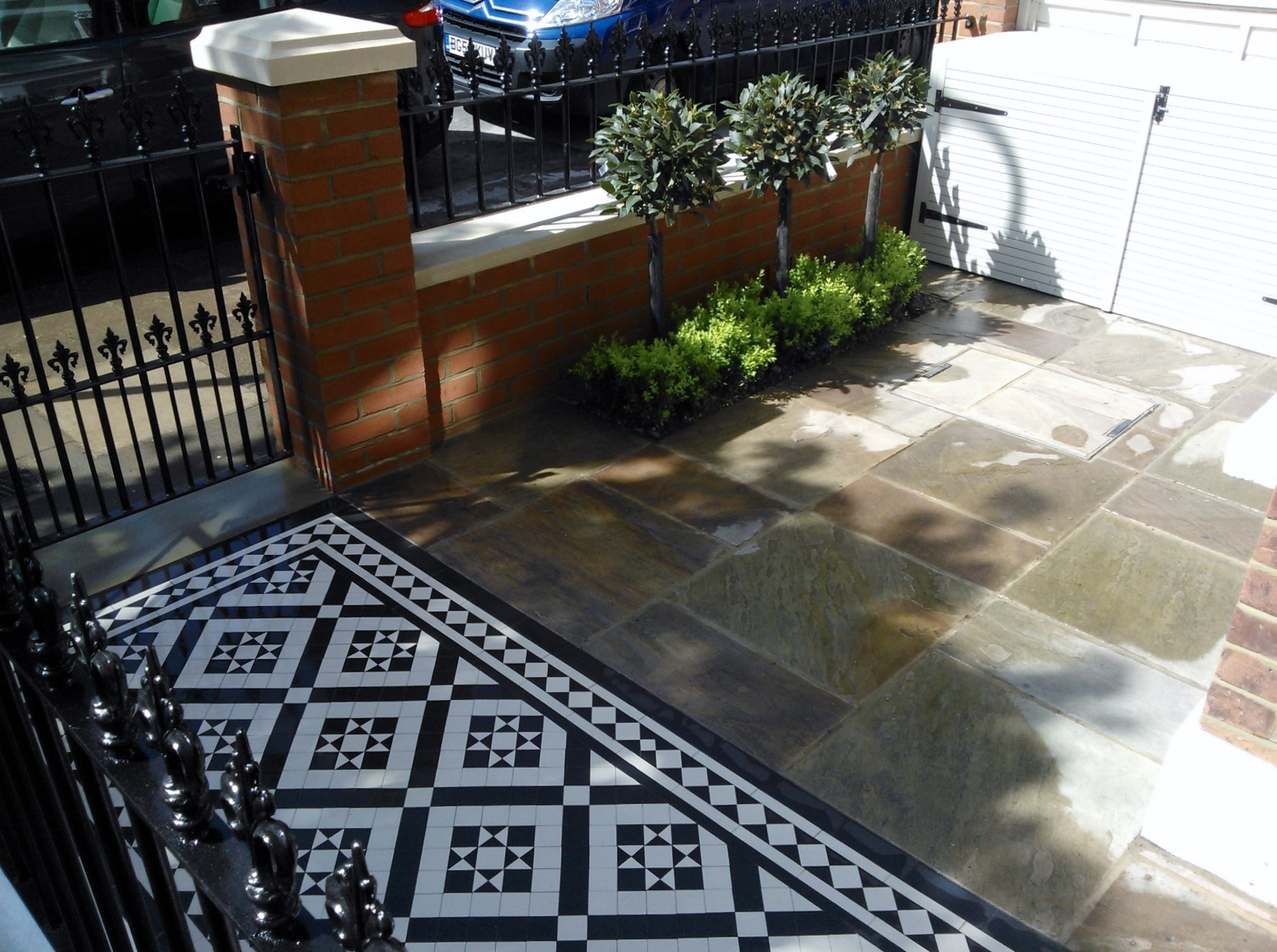 victorian mosaic tile path sandstone paving red brick wall with yorkstone cap bin store and formal planting west london (1)