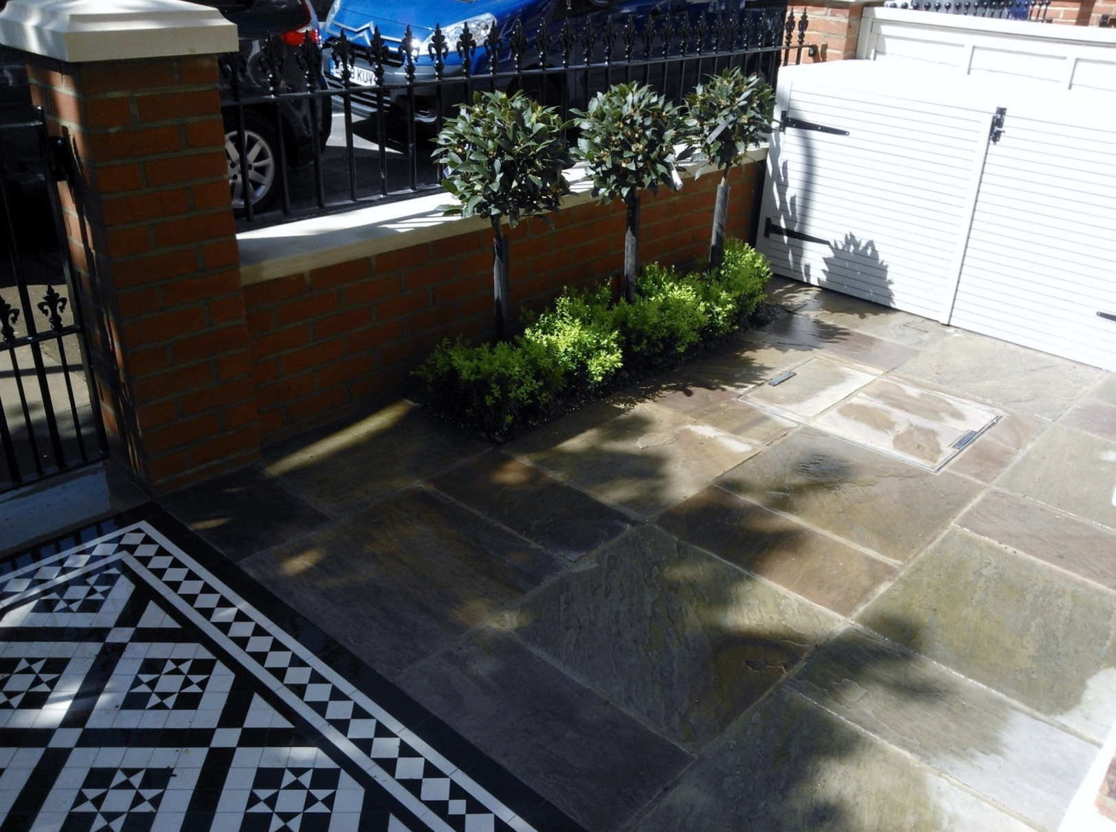 victorian mosaic tile path sandstone paving red brick wall with yorkstone cap bin store and formal planting west london (2)