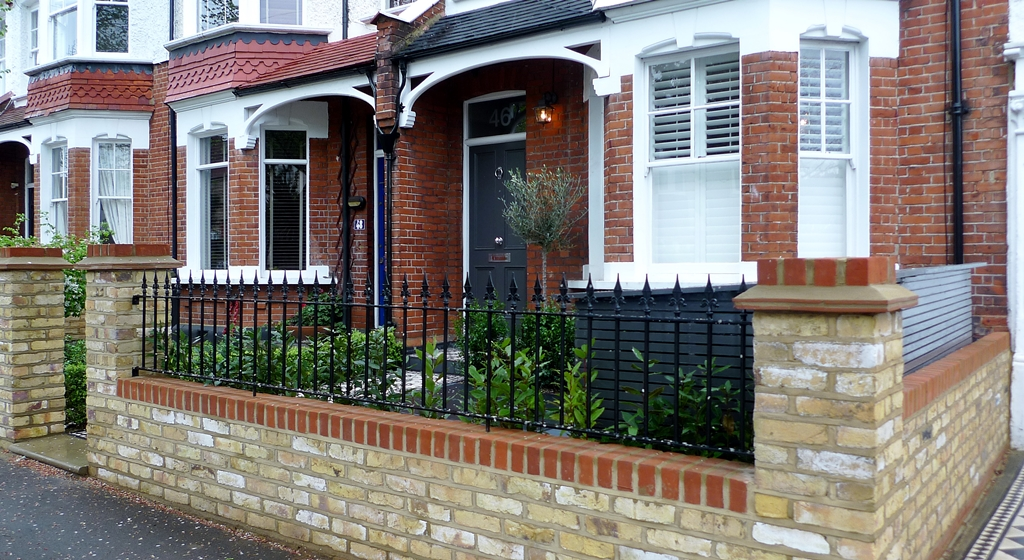 yellow brick front garden wall with rail wimbledon london