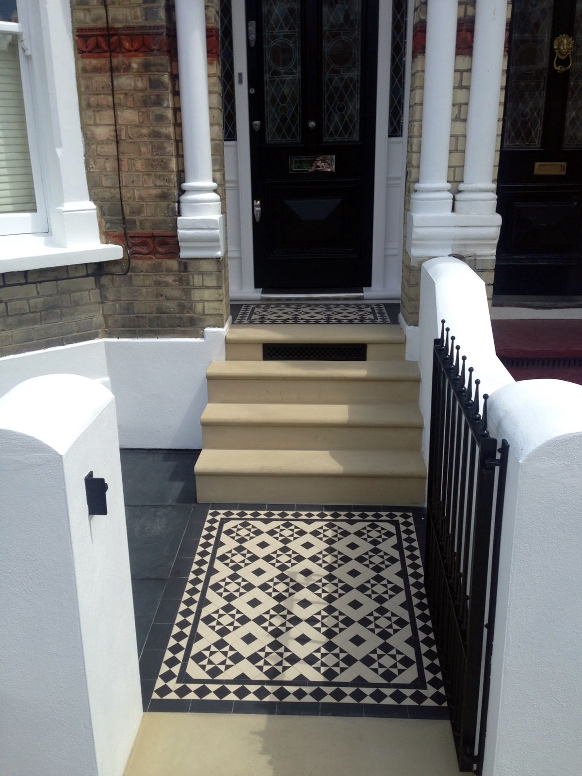 bull nose york stone steps daisy grate victorian mosaic tile path wrought iron rail and gate clapham london rendered painted garden wall black and white