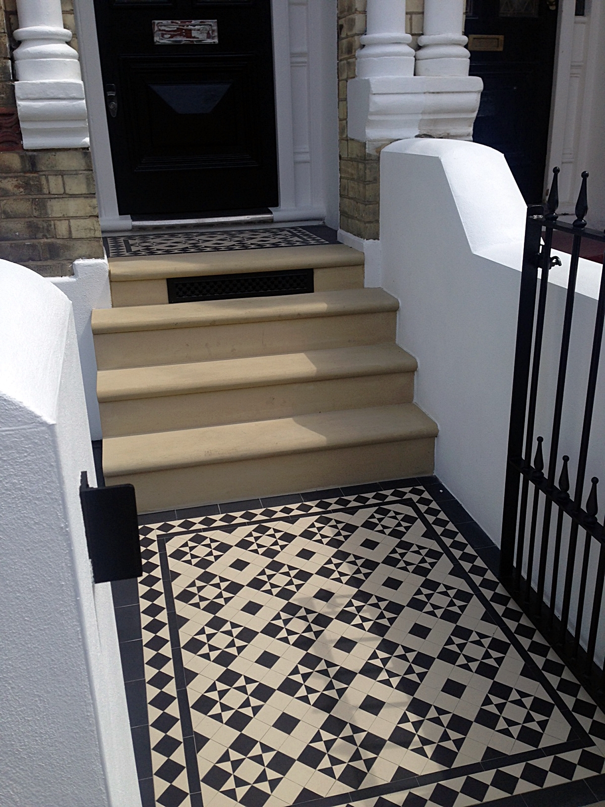 bull nose york stone steps daisy grate victorian mosaic tile path wrought iron rail and gate clapham london rendered painted garden wall