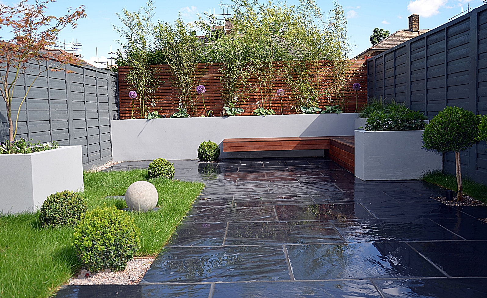 raised beds architectural planting ornamental lawn hardwood screen dark grey modern fence london
