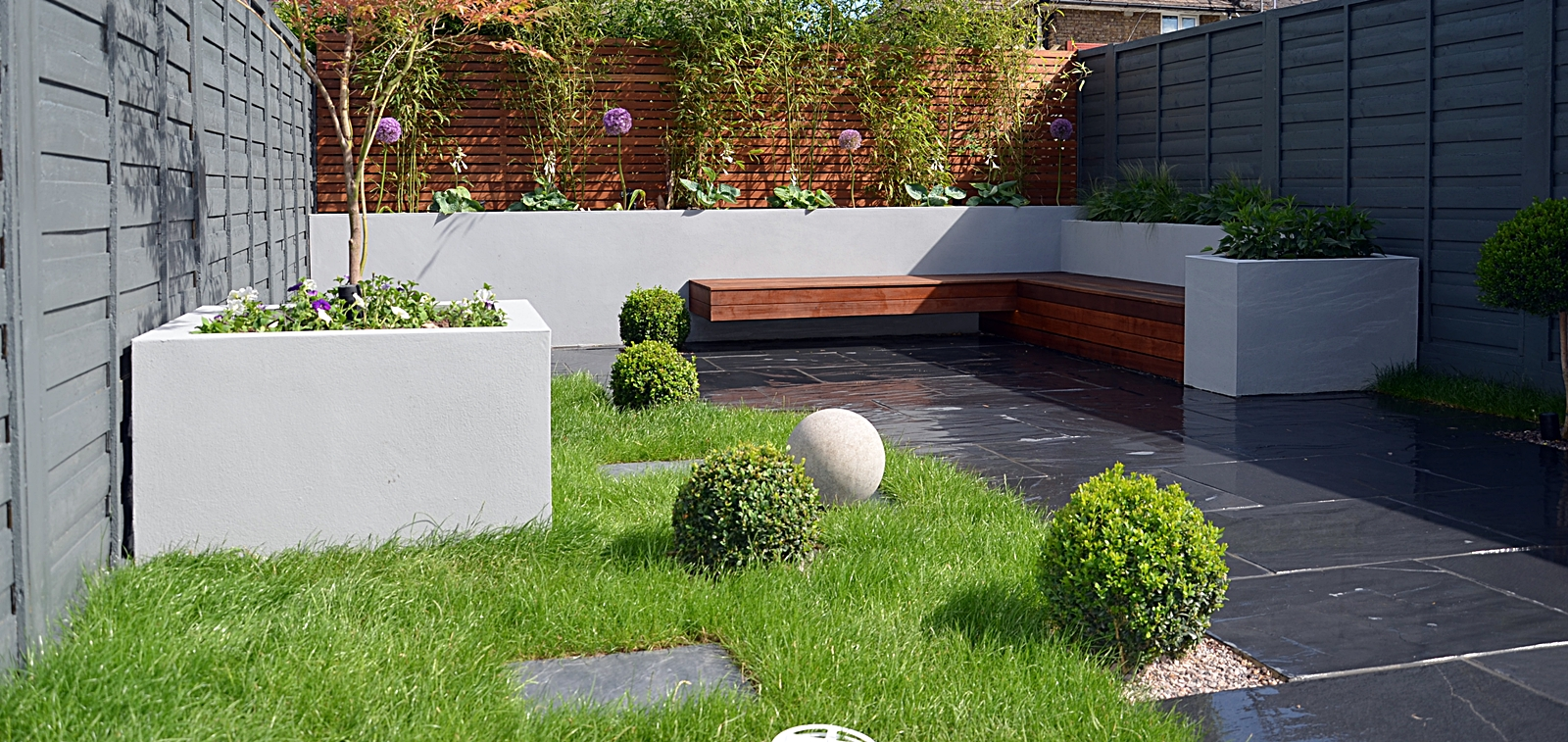 rendered block walls slate paving designer lawn, modern planting london garden design