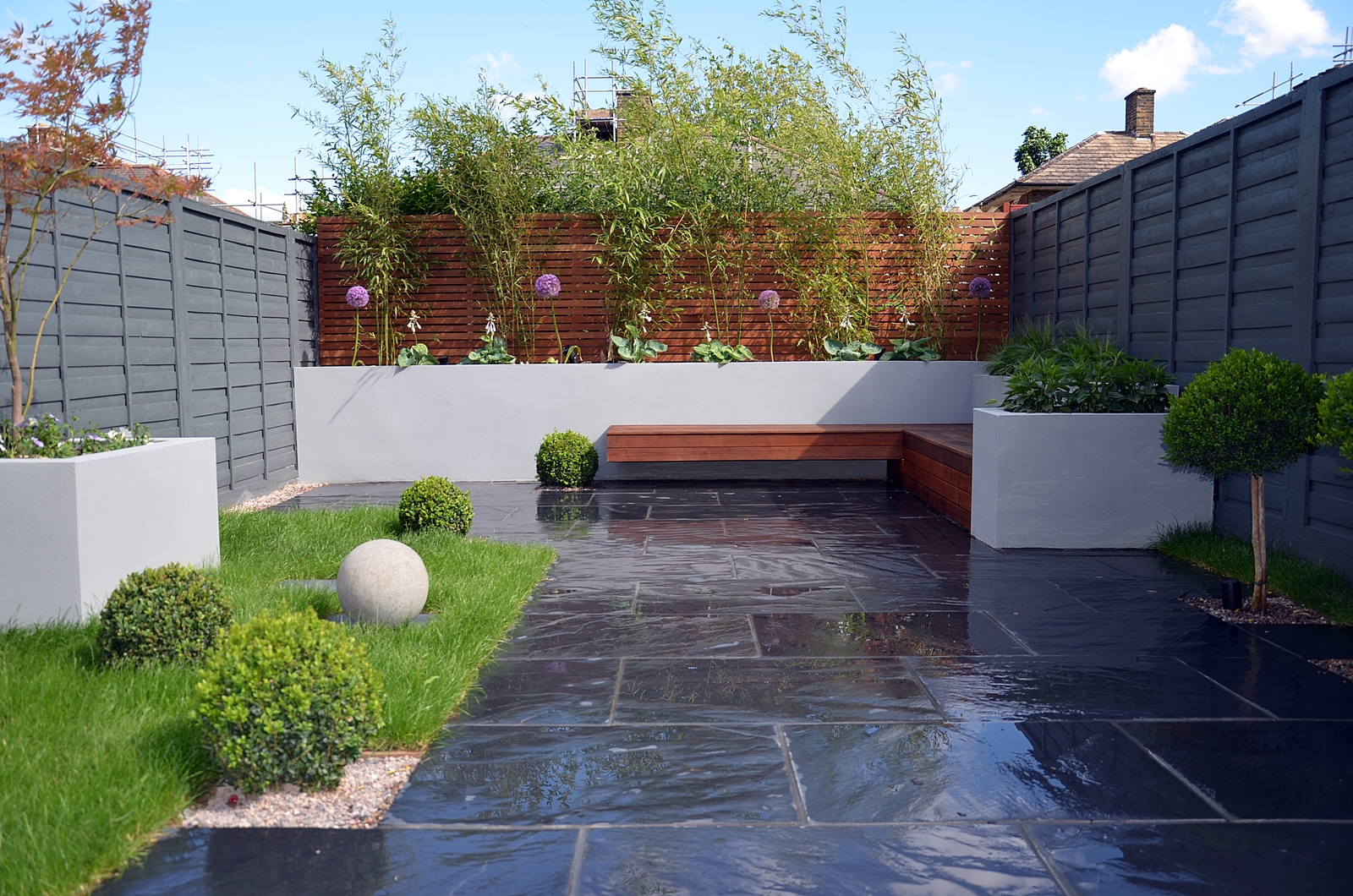 slate paving modern dark grey fence topiary light grey rendered walls london